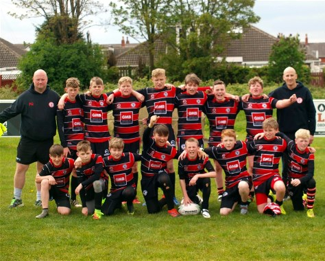 Under 13s team with coaches